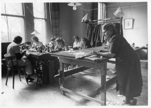 Refugees at work in the Germany Emergency Committee workroom