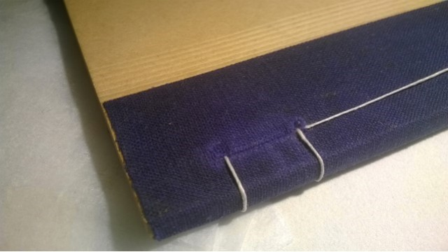 A booklet sewn together after removing staples